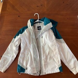 White & teal North Face winter jacket